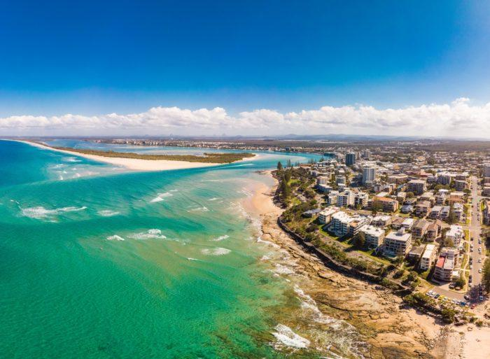 Aerial drone panoramic image of ocean waves on a Kings beach, Caloundra, Queensland, Australia